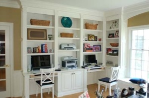 His and her's compartmentalized built-in desk alcoves.
