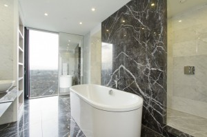 Recessed lights add elegant beauty to this minimalist bathroom, a beauty that comes with an energy price tag.