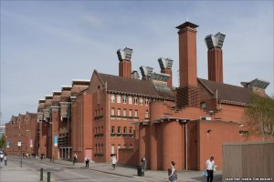 Chimney-like structures at The Queens Building, Leicester University facilitate stack ventilation.